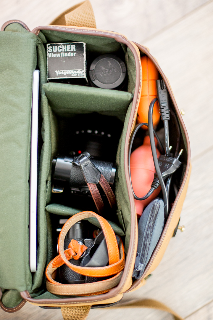 All the contents in the bag. You'll have to stack lenses and the front pocket is pretty much filled up.