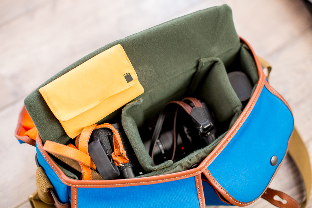 But the camera compartment is better customizable...