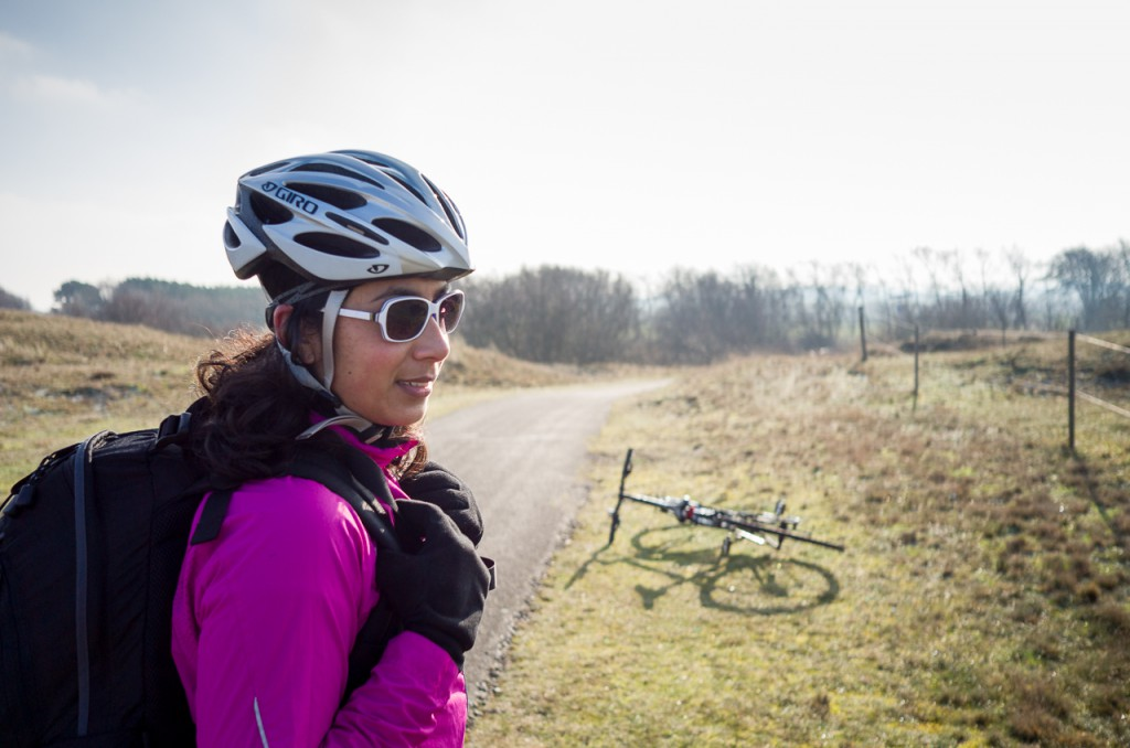 The camera doesn't fit in a cycling jersey, but you could wear it around your shoulder and not notice it at all.