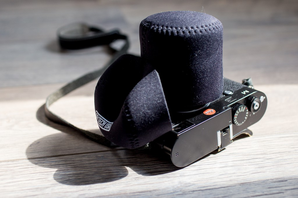 Sliding the pouch on is as easy as putting the lens cap on...