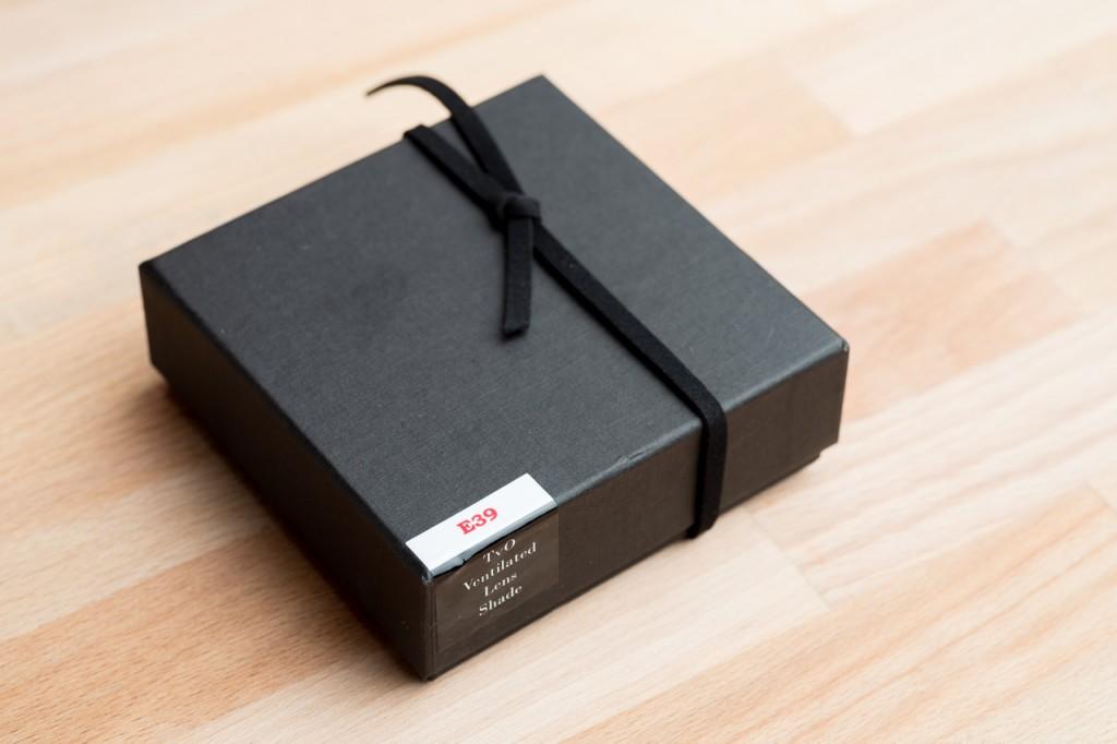 A neat little box with a neat little lens hood.