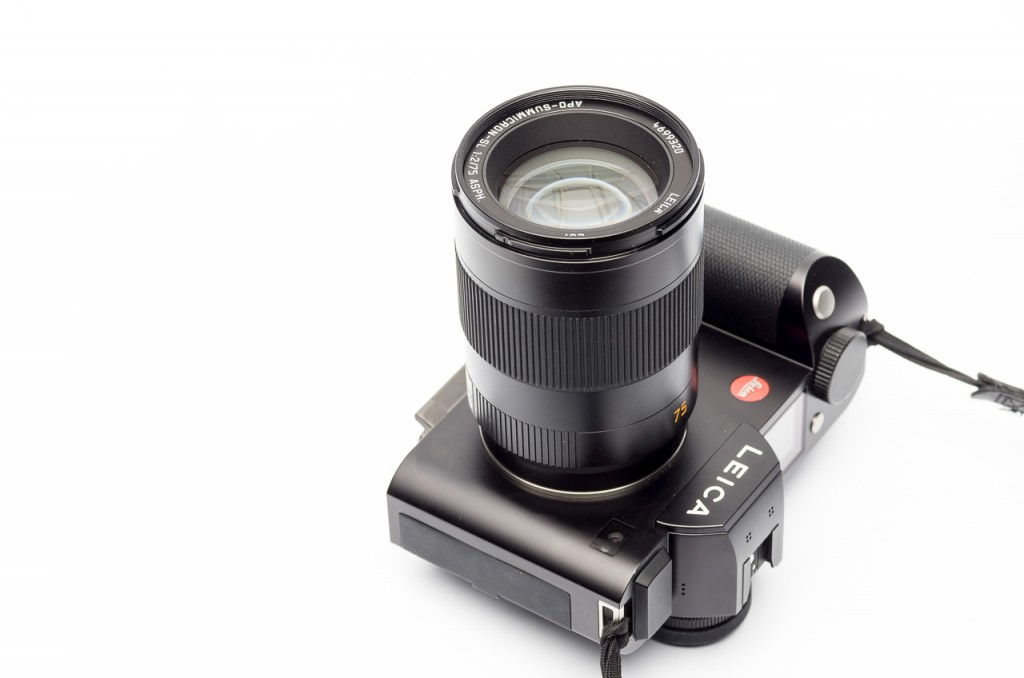 Big and heavy, but well balanced on the SL. Much smaller and lighter than the SL50/1.4 though.