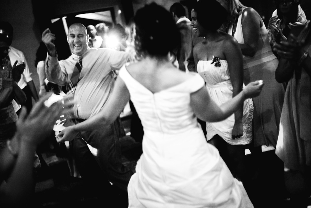 3200 ISO, f1.2, 1/125th was just enough to freeze the action on this wedding.