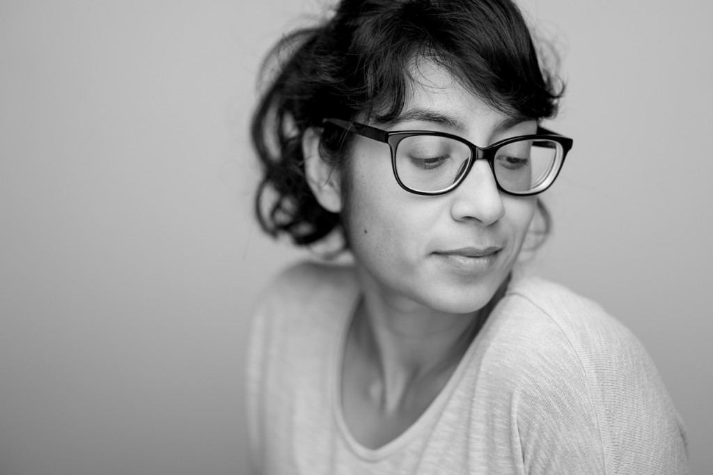 Portrait in a studio setting. If you use flattering light, the lens seems less brutal than the Summarit 75.